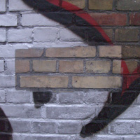 Visibly removes graffiti from brick covering
